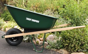 A Shiny, Green Wheel Barrel