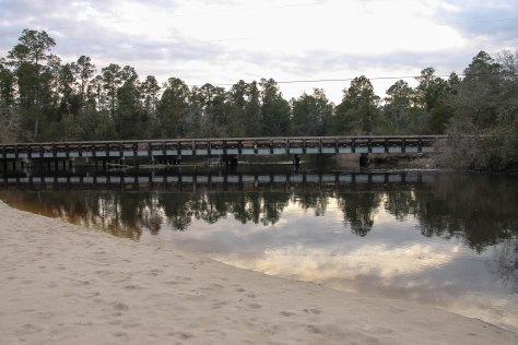 Old Bridge leading to Blackwater River Campground. Beach in the foreground.