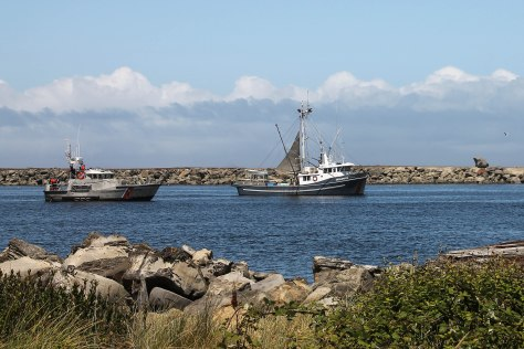 Fishing Vessel followed by Coast Guard boat